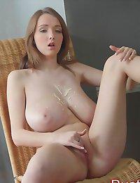 Busty Buffy rubs & sucks on her impressive huge boobs