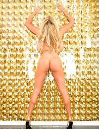 Kelly does a photo shoot in a gold butterfly outfit and fingers herself.